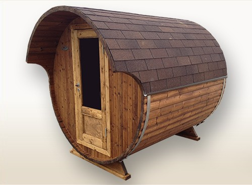 small and practical wooden barrel sauna with electrical heater. Black Bedroom Furniture Sets. Home Design Ideas